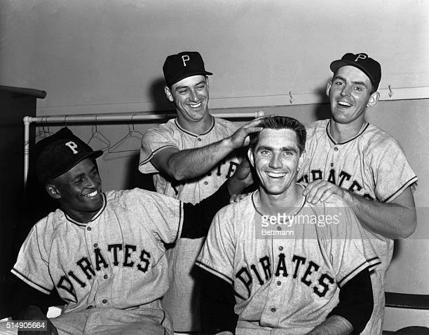 Jubilant members of the Pittsburgh Pirates celebrate in dressing room here 6/6 after beating the Cubs 82 to retain their slim lead as league leaders...