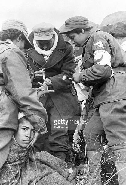6/6/1957Saharan Atlas Mts Algeria This young Moslem lad is having his injured hand checked by two nursesmembers of the 30000 man Algerian Army of...