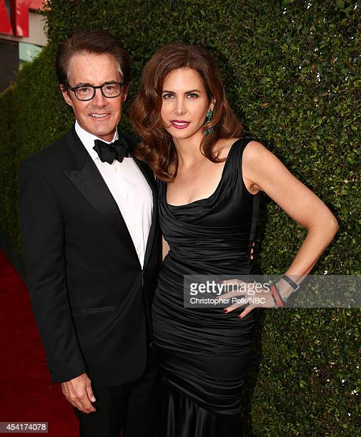 66th ANNUAL PRIMETIME EMMY AWARDS Pictured Actor Kyle MacLachlan and Desiree Gruber arrive to the 66th Annual Primetime Emmy Awards held at the Nokia...