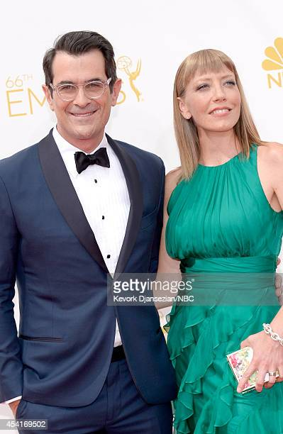 66th ANNUAL PRIMETIME EMMY AWARDS Pictured Actor Ty Burrell and Holly Anne Brown arrive to the 66th Annual Primetime Emmy Awards held at the Nokia...