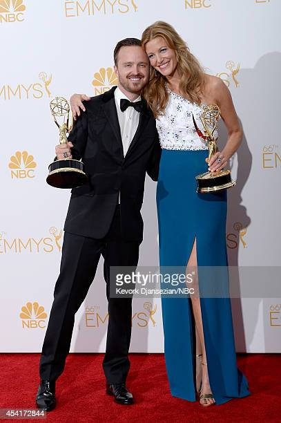 66th ANNUAL PRIMETIME EMMY AWARDS Pictured Actors Aaron Paul and Anna Gunn winners of Outstanding Drama Series for Breaking Bad pose in the press...