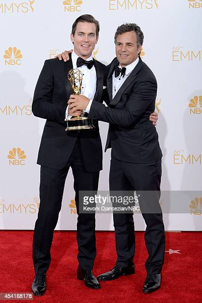 66th ANNUAL PRIMETIME EMMY AWARDS Pictured Actors Matt Bomer and Mark Ruffalo winners of Outstanding Television Movie for The Normal Heart pose in...