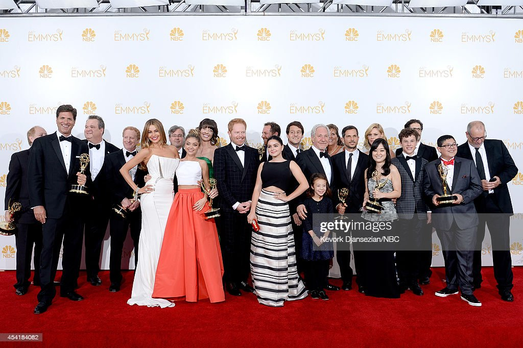 66th ANNUAL PRIMETIME EMMY AWARDS -- Pictured: (l-r) Actors Sarah Hyland, Sofía Vergara, Aubrey Anderson-Emmons, Julie Bowen, Ariel Winter, Jesse Tyler Ferguson, Nolan Gould, Rico Rodriguez, Eric Stonestreet and Ed O'Neill with Show Producers, winners of the Outstanding Comedy Series Award for 'Modern Family' pose in the press room during the 66th Annual Primetime Emmy Awards held at the Nokia Theater on August 25, 2014.