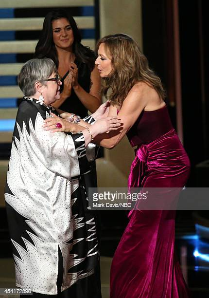 66th ANNUAL PRIMETIME EMMY AWARDS Pictured Actress Allison Janney presents Kathy Bates the Outstanding Supporting Actress in a Miniseries or Movie...