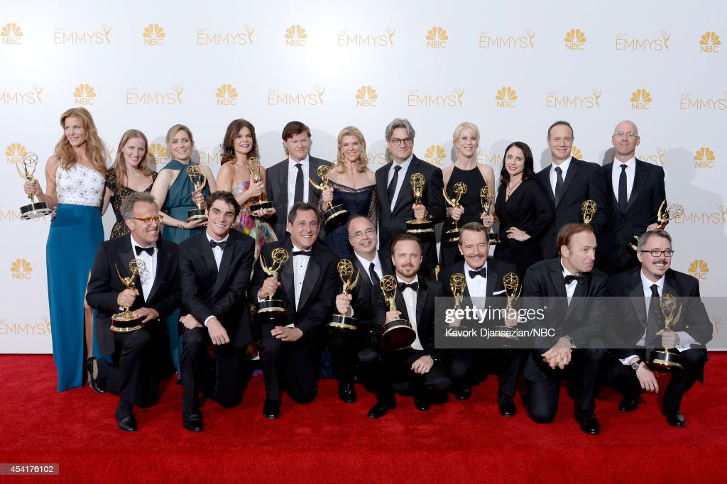 66th ANNUAL PRIMETIME EMMY AWARDS -- Pictured: (top l-r) Actress Anna Gunn, co-executive producer Melissa Bernstein, ---, actress Betsey Brandt, actor Jesse Plemmons, executive producer Michelle Maclaren, co-executive producers Peter Gould, Moira Walley-Beckett actress Laura Fraser, co-executive producers George Mastras, Sam Catlin, (front l-r) executive producer Mark Johnson, actor RJ Mitte, producer Stewart A. Lyons, co-executive producer Thomas Schnauz, actors Aaron Paul, Bryan Cranston, Bob Odenkirk, and executive producer Vince Gilligan, winners of Outstanding Drama Series for 'Breaking Bad' pose in the press room during the 66th Annual Primetime Emmy Awards held at the Nokia Theater on August 25, 2014.
