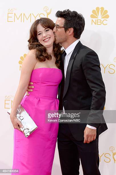66th ANNUAL PRIMETIME EMMY AWARDS -- Pictured: Actress Zooey Deschanel and producer Jacob Pechenik arrive to the 66th Annual Primetime Emmy Awards...