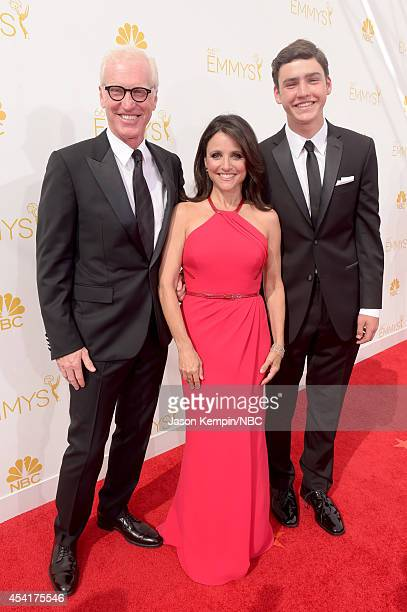 66th ANNUAL PRIMETIME EMMY AWARDS Pictured Brad Hall actress Julia LouisDreyfus and Charles Hall arrive to the 66th Annual Primetime Emmy Awards held...