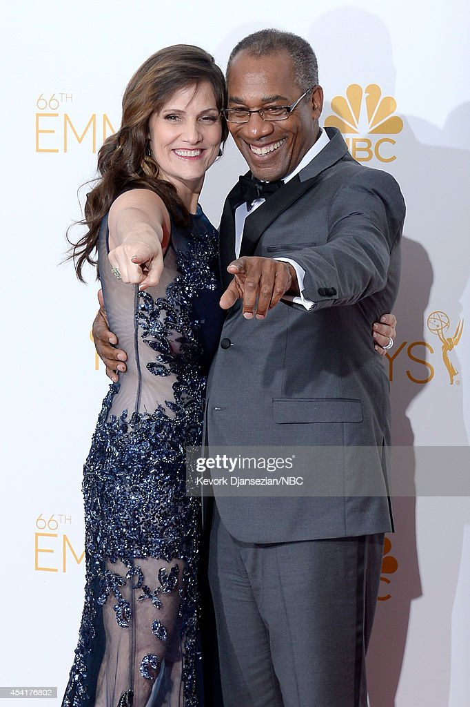 66th ANNUAL PRIMETIME EMMY AWARDS -- Pictured: Christine Lietz (L) and actor Joe Morton pose in the press room during the 66th Annual Primetime Emmy Awards held at the Nokia Theater on August 25, 2014.
