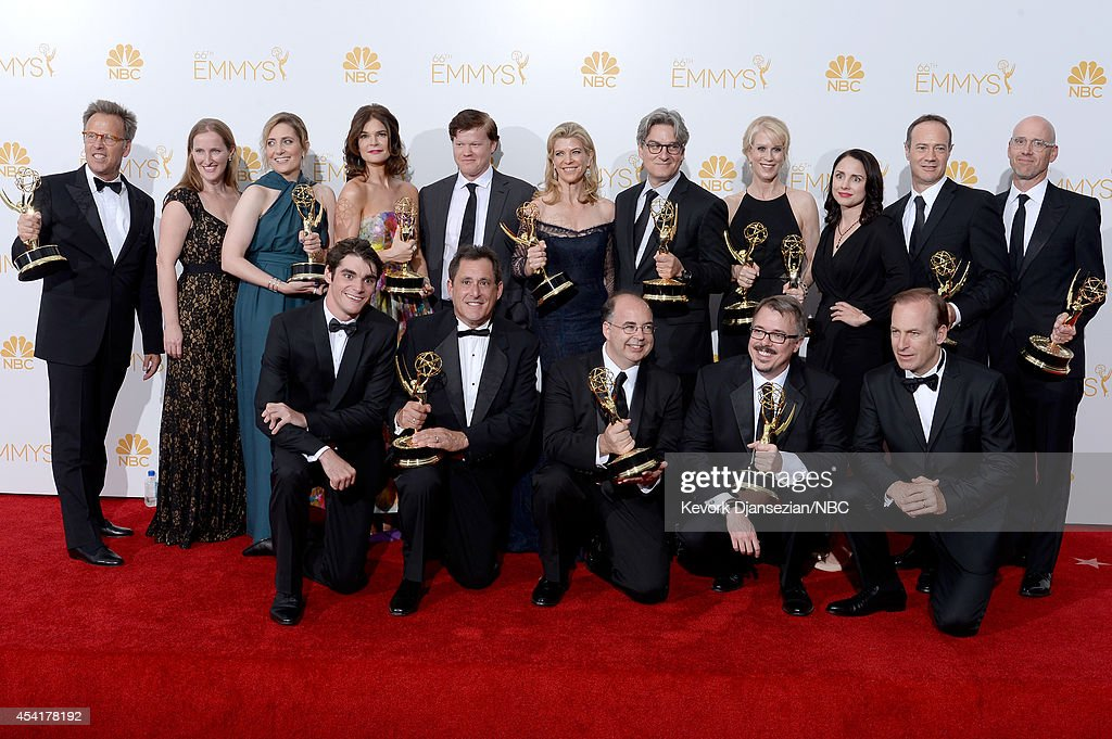 66th ANNUAL PRIMETIME EMMY AWARDS -- Pictured: (top l-r) Executive producer Mark Johnson, co-executive producer Melissa Bernstein, producer Diane Mercer, actress Betsey Brandt, actor Jesse Plemmons, executive producer Michelle MacLaren, co-executive producer Peter Gould, co-executive producer Moira Walley-Beckett, actress Laura Fraser, co-executive producer George Mastras, co-executive producer Sam Catlin, (front l-r) actor RJ Mitte, producer Stewart A. Lyons, co-executive producer Thomas Schnauz, executive producer Vince Gilligan, and actor Bob Odenkirk, winners of Outstanding Drama Series for 'Breaking Bad' pose in the press room during the 66th Annual Primetime Emmy Awards held at the Nokia Theater on August 25, 2014.