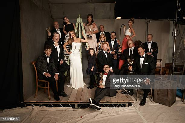 66th ANNUAL PRIMETIME EMMY AWARDS Pictured 'Modern Family' cast and crew Nolan Gould Eric Stonestreet Ariel Winter Sofia Vergara Aubrey...