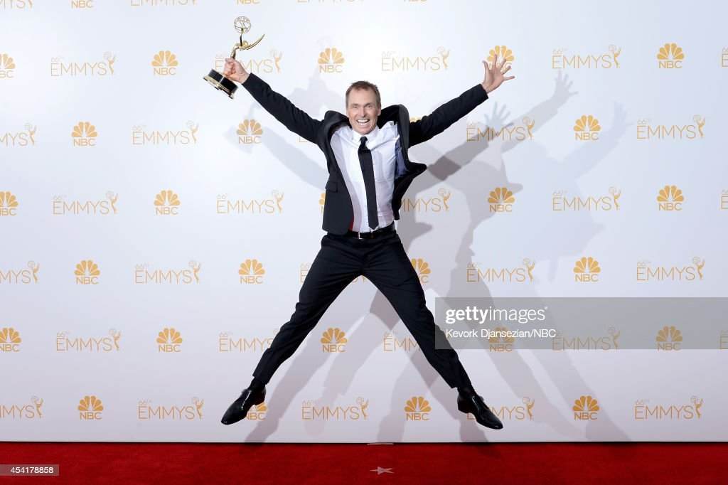 66th ANNUAL PRIMETIME EMMY AWARDS -- Pictured: TV Host Phil Keoghan, winner of Outstanding Reality-Competition Program for 'The Amazing Race,' poses in the press room during the 66th Annual Primetime Emmy Awards held at the Nokia Theater on August 25, 2014.