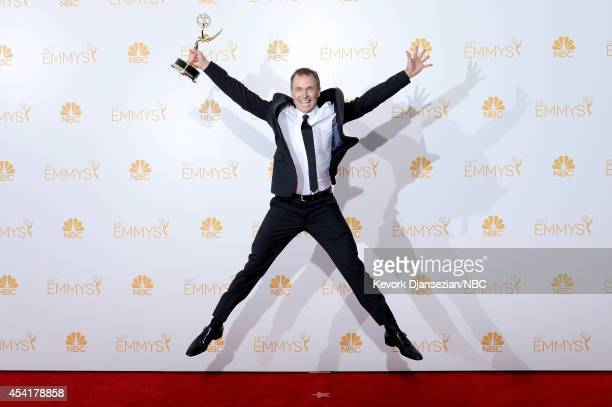 66th ANNUAL PRIMETIME EMMY AWARDS Pictured TV Host Phil Keoghan winner of Outstanding RealityCompetition Program for 'The Amazing Race' poses in the...