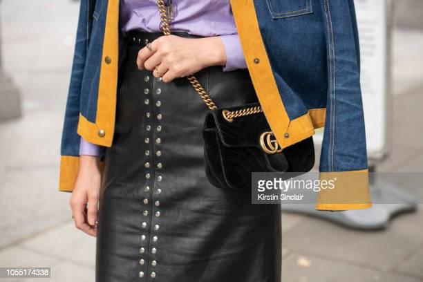 66'tModel Sif Agustsdottir wears an Alexa Chung shirt and skirt Thomas Tate jacket Gucci bag during London Fashion Week September 2018 on September...
