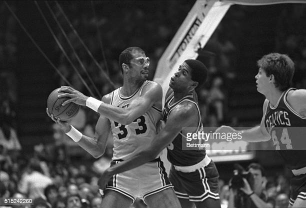 6/7/1985Inglewood CA Boston Celtic center Robert Parish tries to swat the ball away from Lakers' Kareem AbdulJabbar during the 3rd period in the NBA...