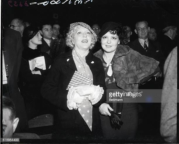 6/8/1935Hollywood CA Two famous screen sirens Clara Bow and Mae Murray stand as is the custom before a main event at the Hollywood Legian Stadium Mae...