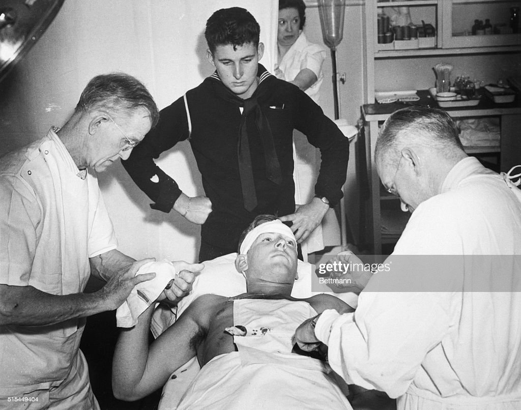 Los Angeles, CA- Aftermath of a night of pitched battles between service men and Pachucos. Donald Jackson, on operating table, and James R. Phelps, both Coast Guard men, were attacked and Jackson was stabbed by a gang of zoot-suiters today.