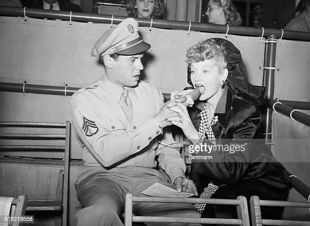 6/8/1945Hollywood CAEven as you and I Hollywood glamor gals relish a bit of beef when they can get it these days About to put the bite on a hot dog...