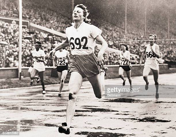 London, England- OLYMPIC GAMES, WEMBLEY STADIUM. DUTCHWOMAN WINS THIRD OLYMPIC TITLE. Photo shows Fanny Blanker-Koen as she becomes the first triple...