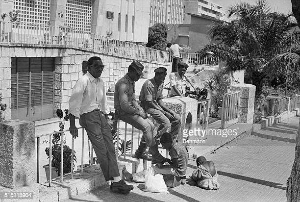 6/8/1976Luanda AngolaAn Angolan boy cleans the boots of a Cuban soldier in Luanda Cuban troops helped the regime of Angola's Marxist President...