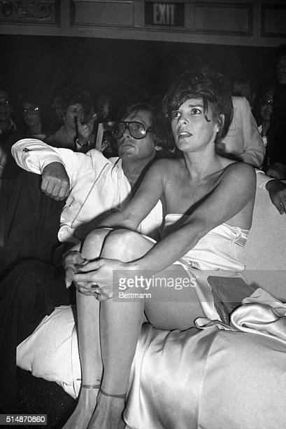 With former husband Robert Evans by her side actress Ali MacGraw is something to see as she sees something of interest during a party at Studio 54...