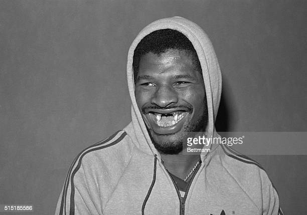 Detroit, Michigan-ORIGINAL CAPTION READS: Former heavyweight champ Leon Spinks shows off his famous smile after he arrived in Detroit to continue...