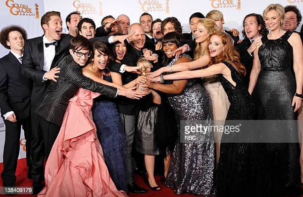 """68th ANNUAL GOLDEN GLOBE AWARDS -- Pictured: Winner of Best Television Series - Comedy Or Musical for """"Glee"""": cast and producers Josh Sussman,..."""
