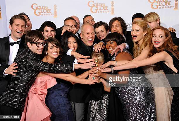 """68th ANNUAL GOLDEN GLOBE AWARDS -- Pictured: Winner of Best Television Series - Comedy Or Musical for """"Glee"""": cast and producers Matthew Morrison,..."""