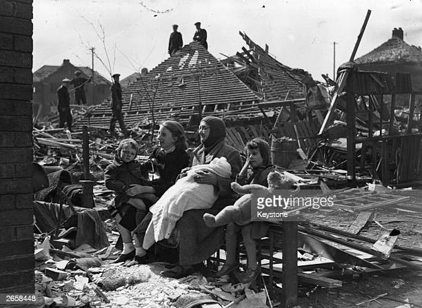 68yearold Mrs Sarah Mason sitting with her four grandchildren in the wreckage of her Liverpool home destroyed by German bombs