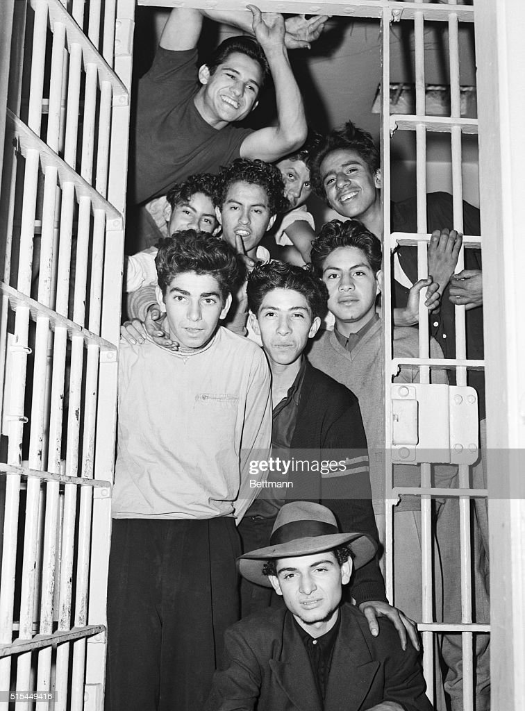 Los Angeles, California- Boisterous lads grin from a cell in the Los Angeles jail, as the institution does land office business as a result of the undeclared war between servicemen and zoot suit clad boys. Although none of these boys are wearing the 'glad plaid,' the gangs who have attacked soldiers and sailors on Los Angeles streets are known as the 'zoot suit crowd.' Because of recent riots, the entire city has been declared out of bounds for sailors.