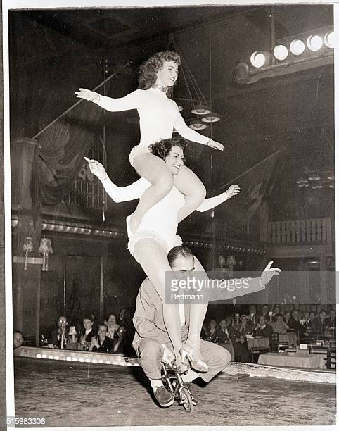 6/9/1957Copenhagen Denmark Performing an unusual feat on a midget bicycle are a group of acrobats from Copenhagen who'll be seen during a tour of the...
