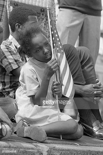 6/9/1968Philadelphia PA A young negro girl holding an American flag watches as the Robert F Kennedy funeral train passes