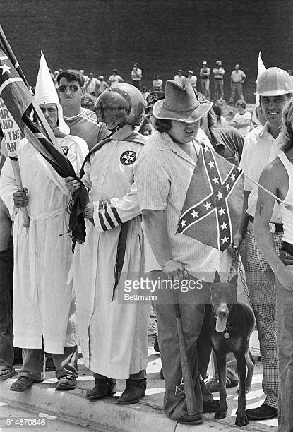 Scene showing Ku Klux Klansmen and supporters gathering to watch demonstrators organized by the Southern Christian Leadership Conference march to...