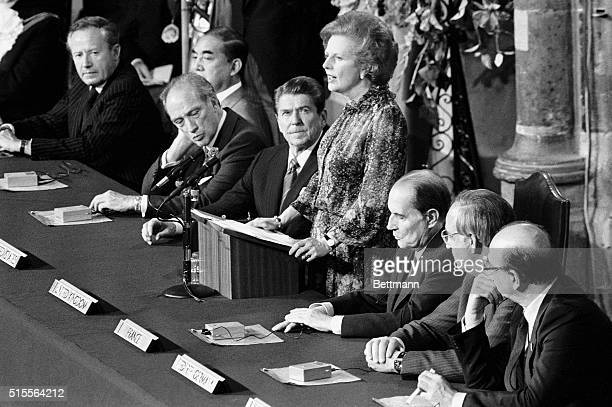 London, England- Prime Minister, Margaret Thatcher , reads the Joint Declaration at Guild Hall at the close of the economic Summit. Left to right...