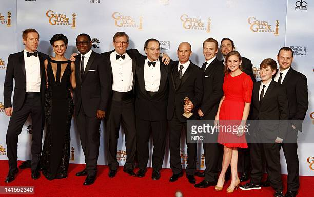 69th ANNUAL GOLDEN GLOBE AWARDS Pictured Cast and producers of Homeland winner of best television series – drama Damian Lewis Morena Baccarin David...