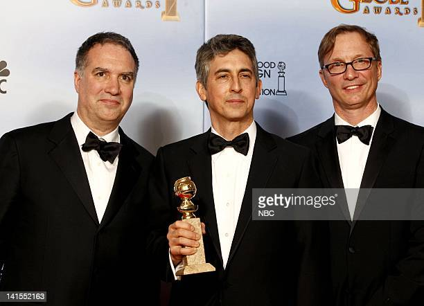 69th ANNUAL GOLDEN GLOBE AWARDS Pictured Producers of The Descendents winner best motion picture drama producer Jim Taylor director Alexander Payne...