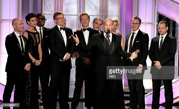 69th ANNUAL GOLDEN GLOBE AWARDS Pictured Unknown Morena Baccarin David Harewood producer Alex Gansa Damian Lewis Mandy Patinkin producer Howard...