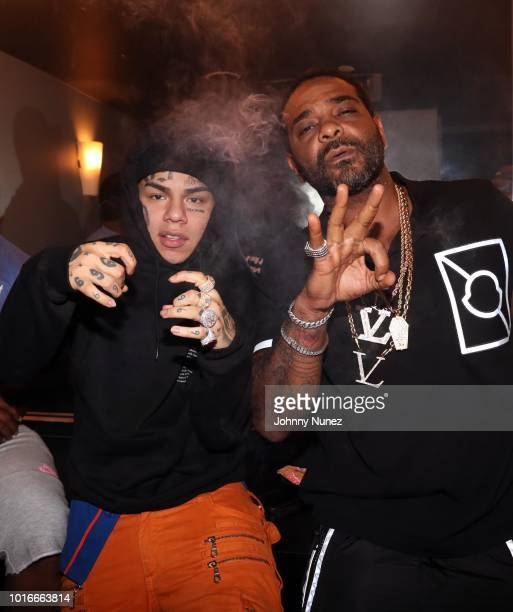 6ix9ine and Jim Jones backstage at PlayStation Theater on August 13 2018 in New York City