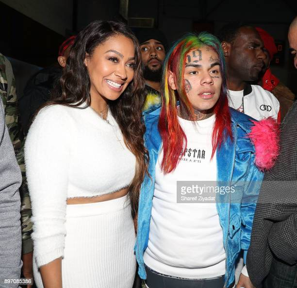6ix9ine and La La Anthony attend La La Anthony Hosts 'Winter Wonderland' Holiday Charity Event on December 21 2017 in New York City