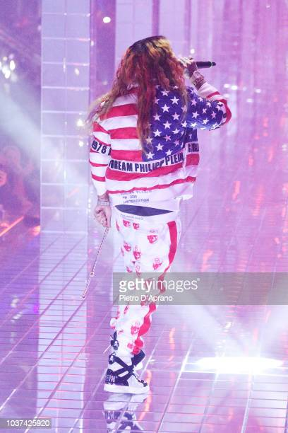 6ix9ine performs on the runway at the Philipp Plein show during Milan Fashion Week Spring/Summer 2019 on September 21 2018 in Milan Italy