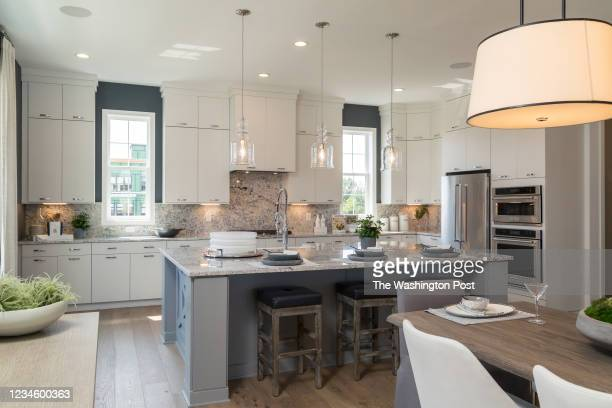 Kitchen and Dining area in the Dylan Model Townhome at Regency at Belmont on August 6, 2021 in Ashburn Virginia.