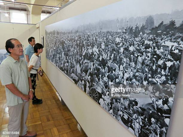 TOKYO Japan A 46meterlong panoramic photo panel showing around 300000 evacuees who gathered at the plaza in front of the Imperial Palace in Tokyo...
