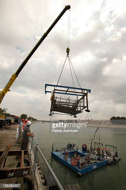 Raising the ancient barge is a very complex operationOne of the 10 sections move with winches toward the quay where a crane will take charge of the...