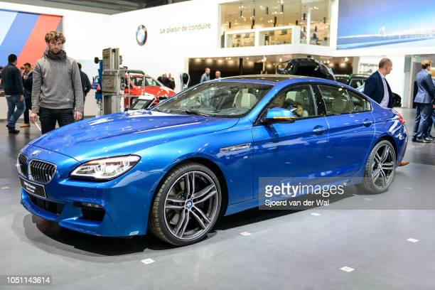 Series Gran Coupe four door performance saloon car in bright blue front side view on display at Brussels Expo on January 13 2017 in Brussels Belgium...