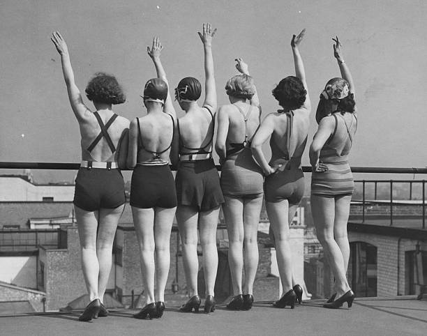 Roof top bathing belles showing off the low back style...
