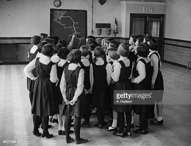 Schoolgirls from the orange Hill Central School Burnt Oak London studying a map of the Rhineland before their Easter trip to Germany