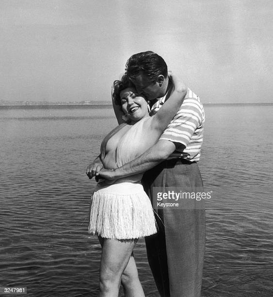 British actress Simone Silva posing with American film star Robert Mitchum during the Cannes film festival Having been elected 'Miss Festival' Simone...