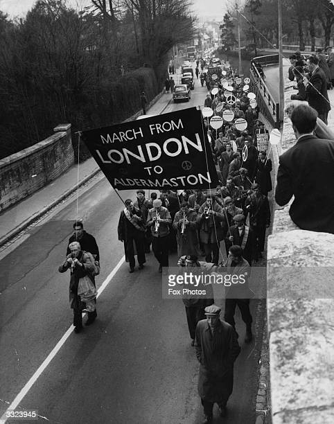Hbomb campaigners marching up Castle Hill Maidenhead during their 45 mile walk from London to the Atomic Weapons Research Establishment at...