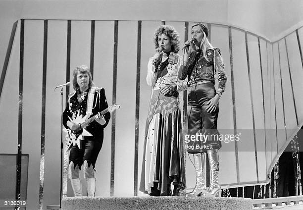 Swedish pop stars Bjorn Ulvaeus AnniFrid Lyngstad and Agnetha Faltskog of ABBA playing live on stage