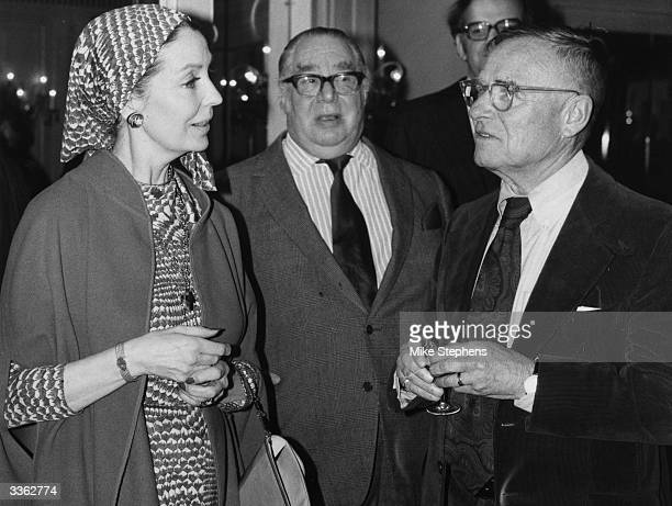 British writer Christopher Isherwood chats to former film actress Valerie Hobson at the Dorchester hotel in London to mark the publication of his...