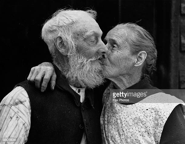 Mr and Mrs George Perry exchange a kiss on the occasion of their diamond wedding